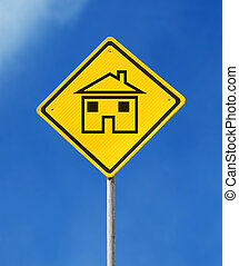 House sign - yellow house sign on sky background