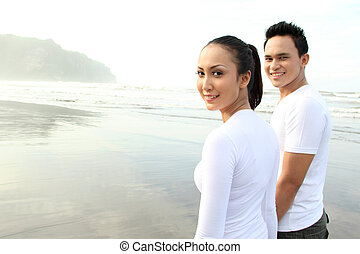 Couple portrait at the beach