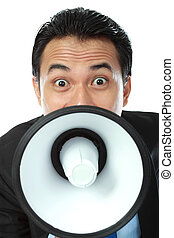 man shouting using megaphone - close up portrait of young...