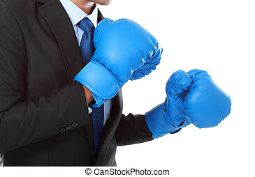 business competition - businessman with boxing glove ready...