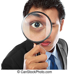 businessman with magnifying glass - business concept -...