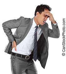 businessman with a headache - Young businessman with a...