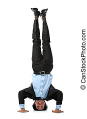 business man doing handstand - Full length of business man...