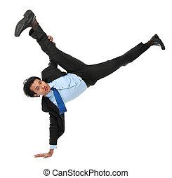 business man doing handstand