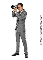 photographer using dslr camera - portrait of professional...