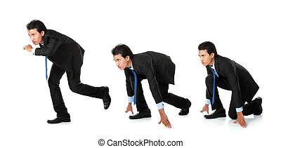 business competition - businessman getting ready for race in...
