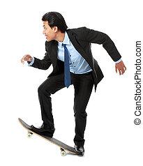 rush hour - asian executive on skateboard isolated on white...