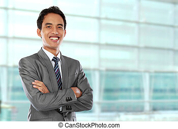 business man - Happy young business man looking at camera...