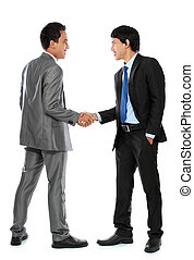 business colleagues shaking hands - Full length of business...