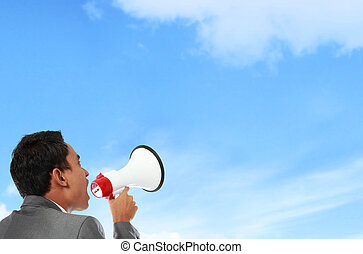 Attention please - business man shouting using megaphone...