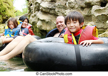 family on inflatable tube - Happy family floating on...