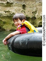 kid having fun in the river