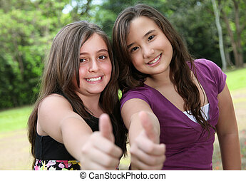 Positivism - two friends raising his finger at the camera...