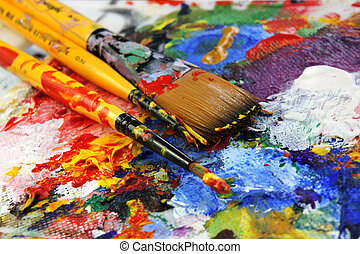 Art palette with a lot of vivid bright colours