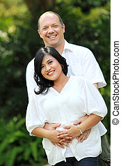 mixed race couple - Portrait of a mixed race couple outside...