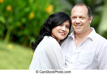 mixed race couple - Portrait of a happy mixed race couple in...