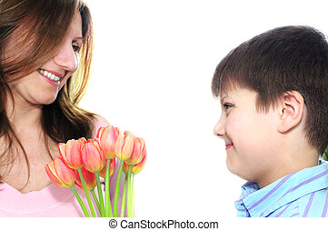 Mother and son with flowers - Mother receiving a bouquet of...
