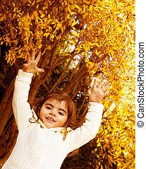 Baby girl in autumn park