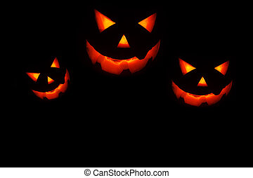 Halloween holiday background with glowing jack-o-lantern in...