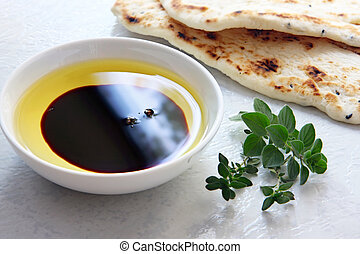 Oil and Vinegar - Oil and vinegar - small bowl of olive oil...