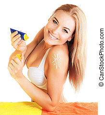 Pretty female apply suntan cream - Photo of cheerful pretty...