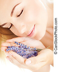 Beautiful girl smell lavender flowers - Photo of beautiful...