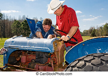 Repairing the Old Tractor - Farmer and ranch hand work on...