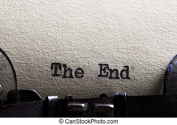 The end... written on an old typewriter and old paper.