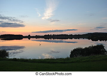 sunset - beautiful sunset over a lake in wicklow ireland