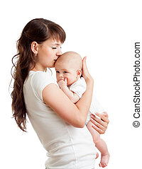 loving mother embracing and kissing her child isolated on...