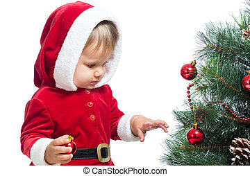 pretty child decorating Christmas tree isolated on white -...