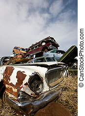 Discarded - A pile of abandoned automobiles in a junk yard