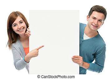 teenagers holding at a blank board - two smiling teenagers...