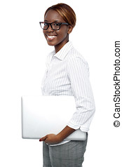Cheerful business consultant carrying laptop
