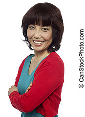 Side pose of smiling asian woman, arms crossed Isolated on...