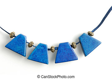 Necklace with blue gems - Close-up of necklace with blue...
