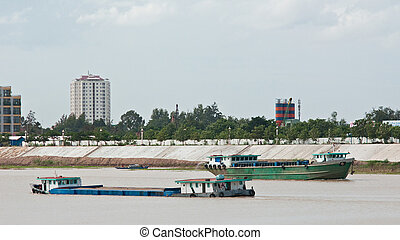 River vessels in Cambodia - River freight vessels meeting on...