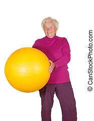 Happy retired woman holding gym ball - Happy overweight...