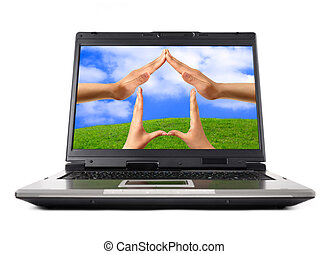 Conceptual Home Symbol - Conceptual Home symbol on a laptop...