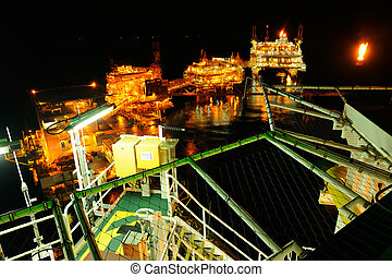 An offshore platform at night in the Gulf of Thailand