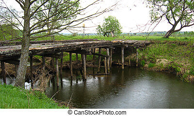 Old almost destroyed bridge across river - Image of old...