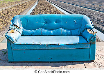 Very old vintage blue sofa on the street, can be use for...