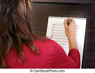 closeup of a woman composing - close view of a woman...