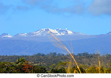 Mauna Kea and Snow capped Peaks - Low elevation view of the...