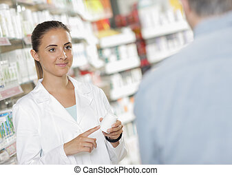 Pharmacy - Senior man talking with woman pharmacist