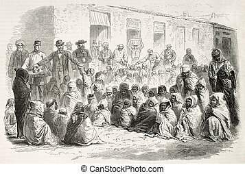 Food distribution by French settlers to Arab population in...