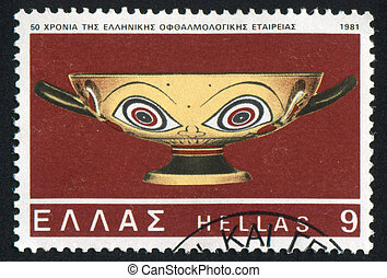Vase with Painted Eyes - GREECE - CIRCA 1981: stamp printed...