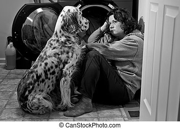 Consoling Friend - Woman crying on the floor while her dog...