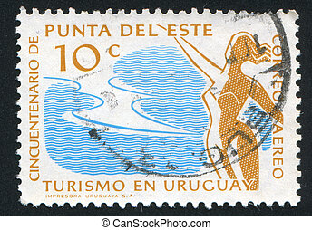 Girl at Seaside Resort - URUGUAY - CIRCA 1959: stamp printed...