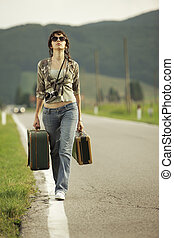 Travel on the road - Young woman runaway walks away road